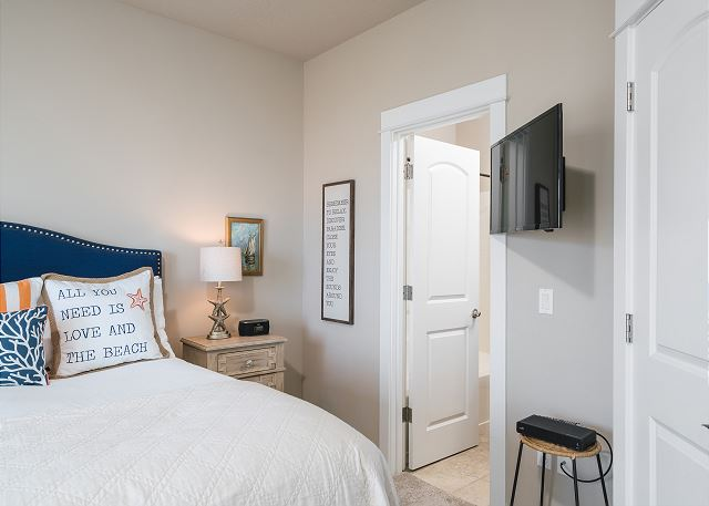 Master bedroom suite includes cable-equipped TV