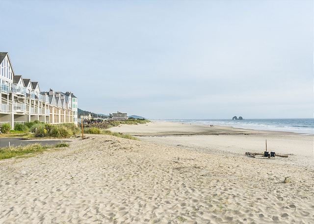 Come walk the miles and miles of soft sand right from the door of this home