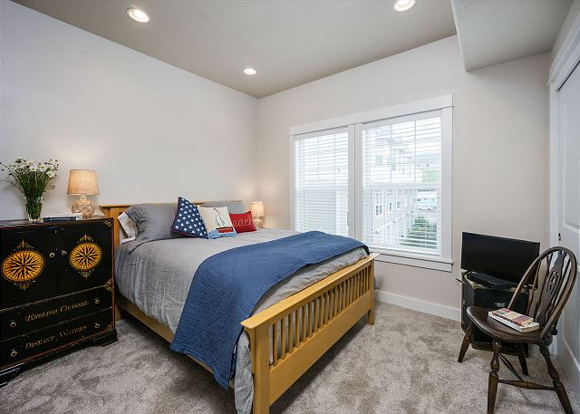 2nd bedroom features a queen bed and TV and adjacent bathroom