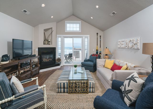 Bright and comfortable 3rd floor living room with large flat screen TV and partial ocean view