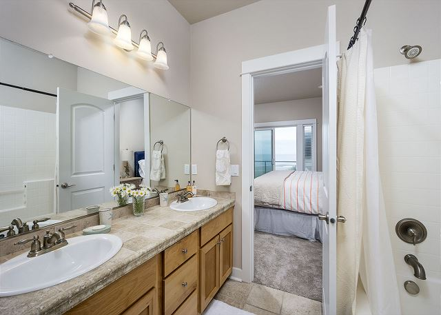 Double sinks in the master bathroom. Also features soaking tub