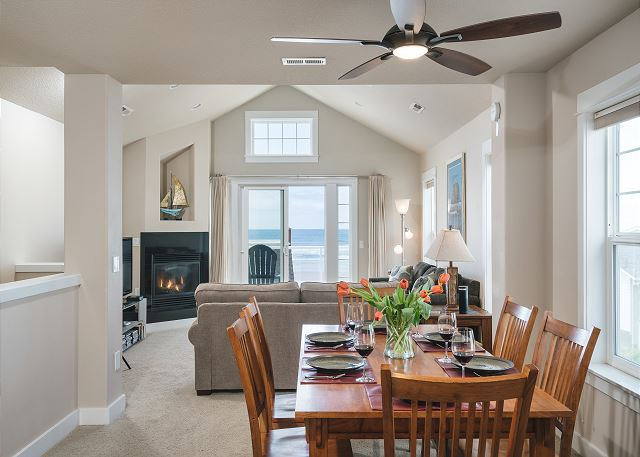 The ceiling fan draws in the ocean air and the table is situated for capturing lovely views