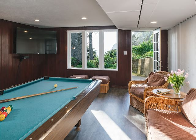Basement/game room with 65