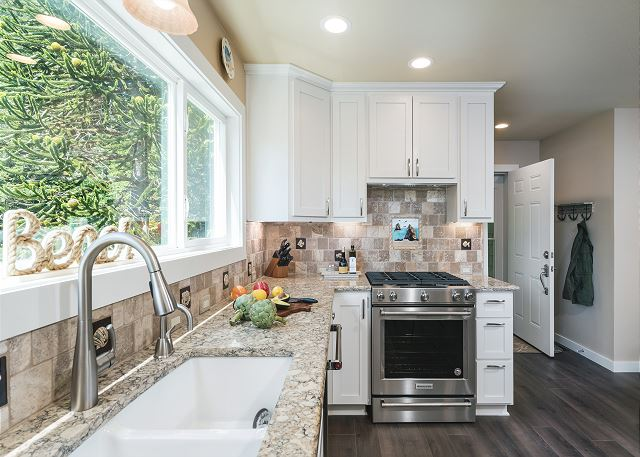 Granite countertops and stainless steel appliances in this newly updated kitchen
