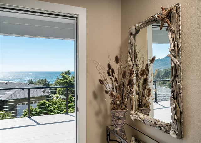 No way to forget you're at the beach with this view and the handcrafted reclaimed driftwood mirror in the entryway