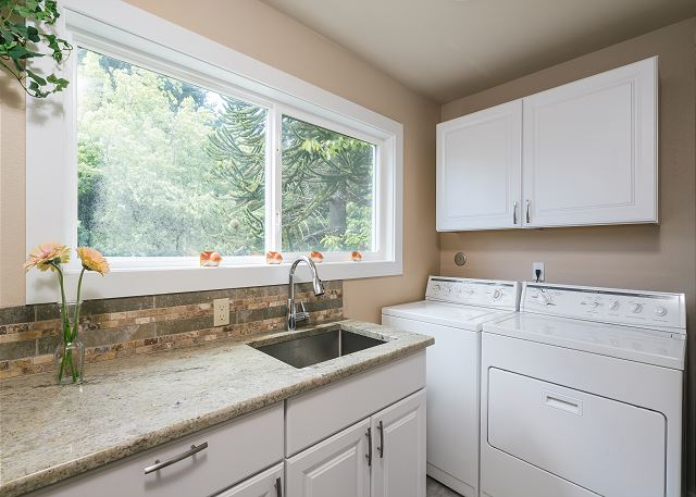 Easily accessible from the front entrance and the kitchen, the laundry room is great to clean your chef whites or your beach clothes alike