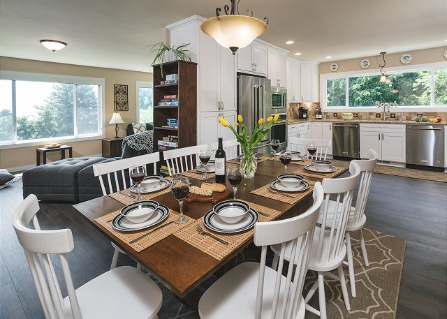 You'll be able to see the ocean and not miss a minute of the culinary magic taking place in the kitchen at this dining table which comfortably seats 8
