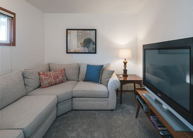 Curl up for movie night in the downstairs media room - options include cable-equipped 50