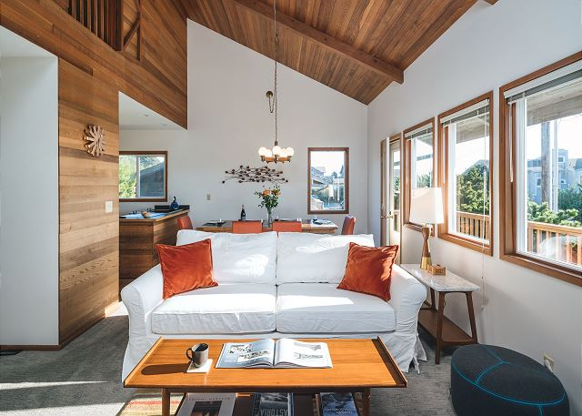 Vaulted wood paneled ceilings and accent wall make this living room feel expansive