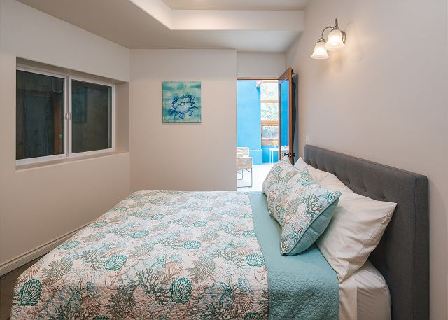 This garden level bedroom with direct access to the colorful atrium gets plenty of bright light
