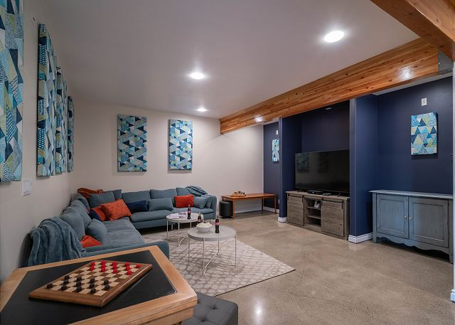 No shortage of comfy cushions for movie night in this ground floor living area