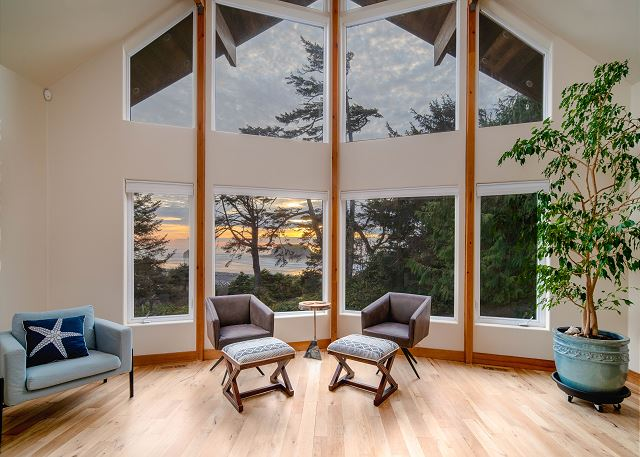 This dramatic two story living room offers breathtaking ocean views through the pines