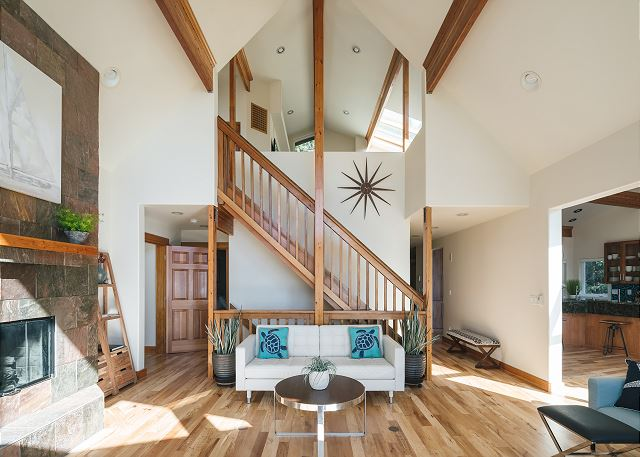 Architectural stairs leading to the loft space perched high above the living room