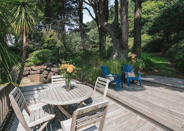 Plenty of deck space for dining or lounging in the solitude of the rear grounds