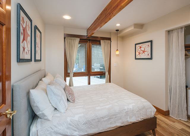 Main floor bedroom with just the right pop of color and views to the rear grounds