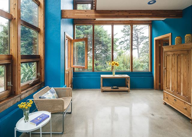 The colorful two story atrium looks out at the ocean and up at the dining room