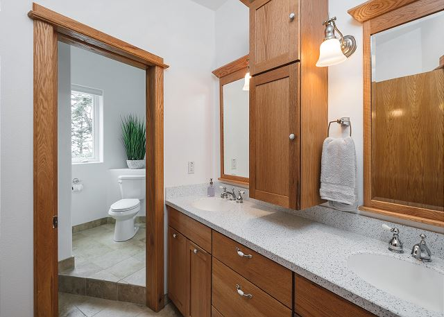 Lower level bathroom with double vanity and exceptional cabinet space