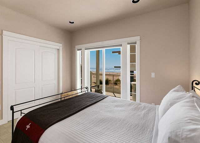 Ocean-facing master bedroom with queen bed