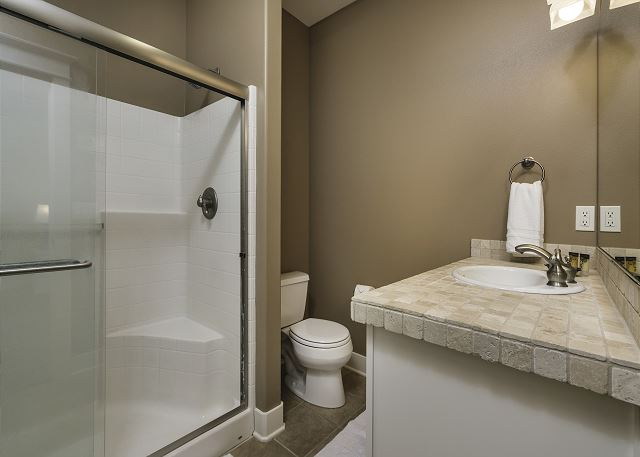 Top floor master bathroom has a large walk-in shower with built in seat