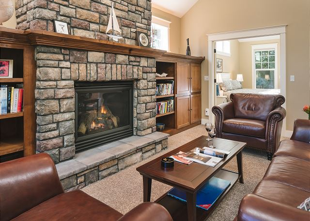 Picture your family all spread throughout this sizable living room with books and games in hand in front of this large fireplace