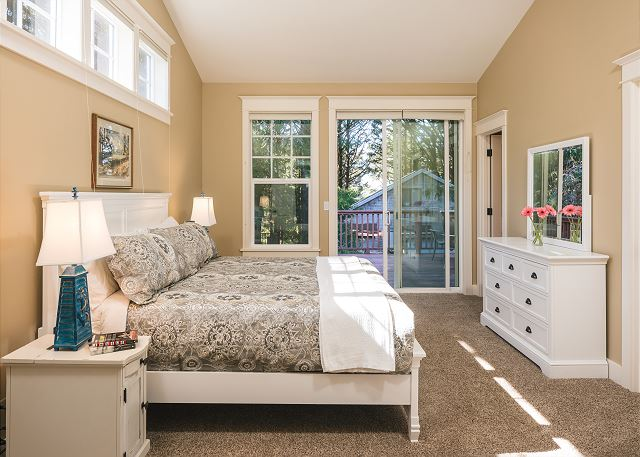 The top floor master has vaulted ceilings, and en suite bathroom, and access to the large back deck