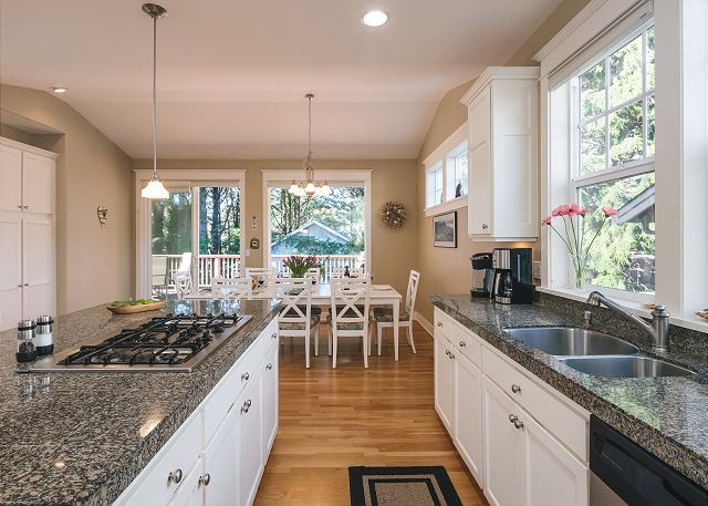 Think of all the chowder you can make on this six burner stove and massive island!