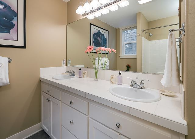 The ground floor master bath has double sinks and a shower/tub combo