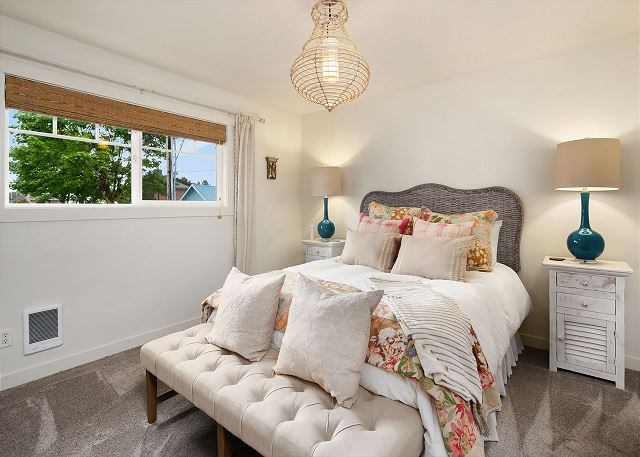 This bedroom is cozy and refined, with new carpet underfoot.