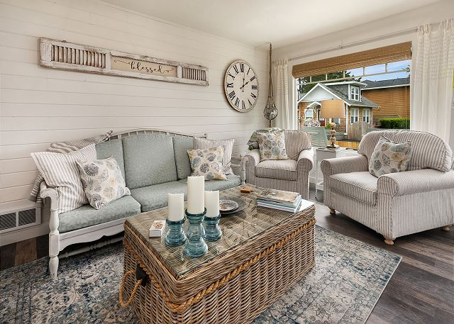 The living room with its sophisticated cottage decor will welcome you home after a long day of soaking in the beach just a short walk away
