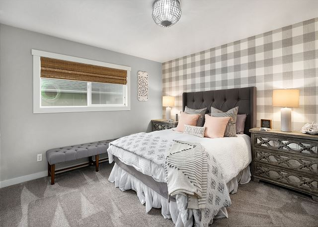 This bedroom has statement wallpaper and super soft bedding