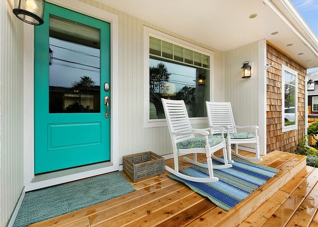 Farmhouse rockers by the front door are a great way to relax after a day at the beach
