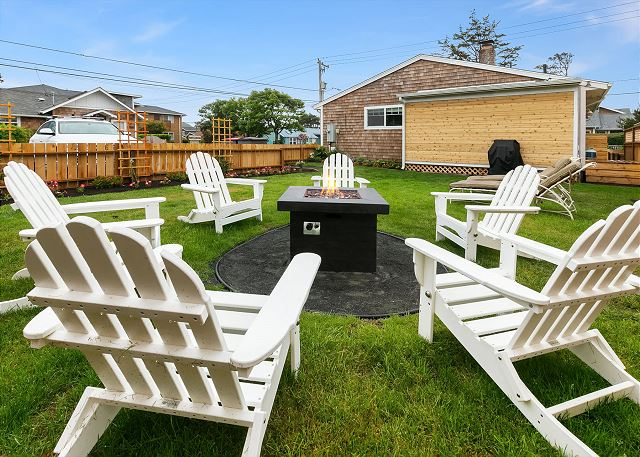 With the kind of grass you can't wait to get your bare feet in, the large fenced back yard has a fire pit and BBQ