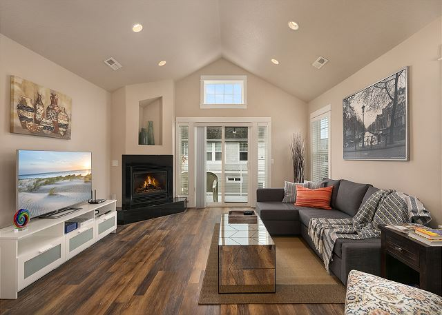 Spacious living room with flatscreen TV and gas fireplace