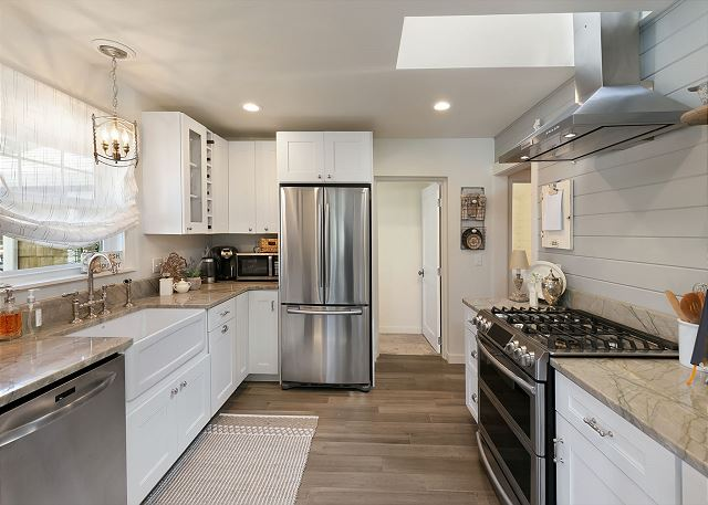 Well-stocked kitchen includes gas range and stainless appliances