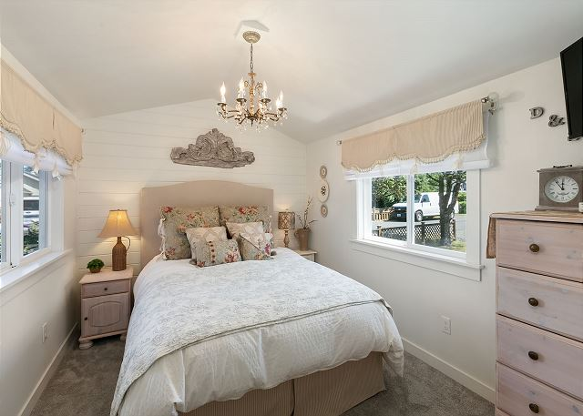Master bedroom with gently vaulted ceiling, quality mattress and linens