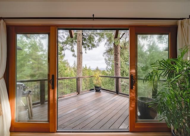One of four wood decks connects the interior with the natural surroundings