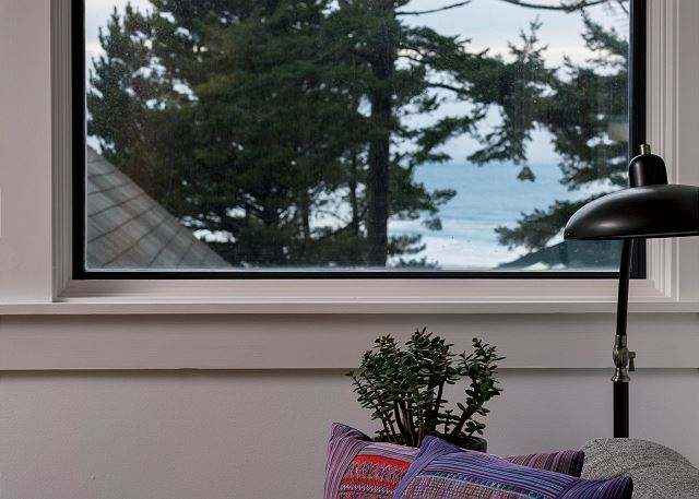 Perfectly situated windows capture the ocean view