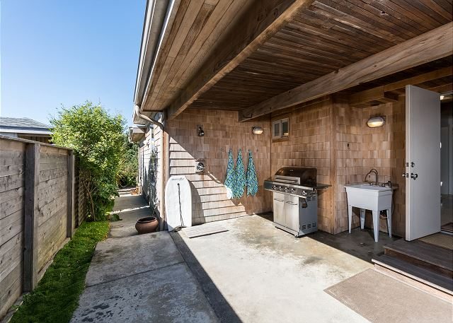 Convenient hot/cold outdoor shower and undercover grill area