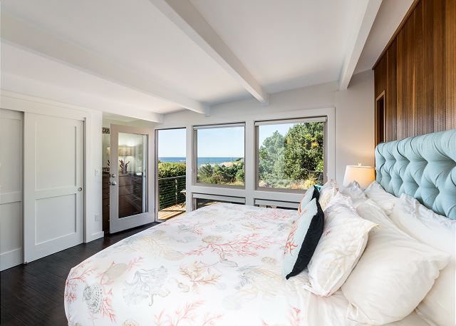 Master bedroom (king bed) with picture windows and direct access to the deck. Awaken to stunning ocean views!