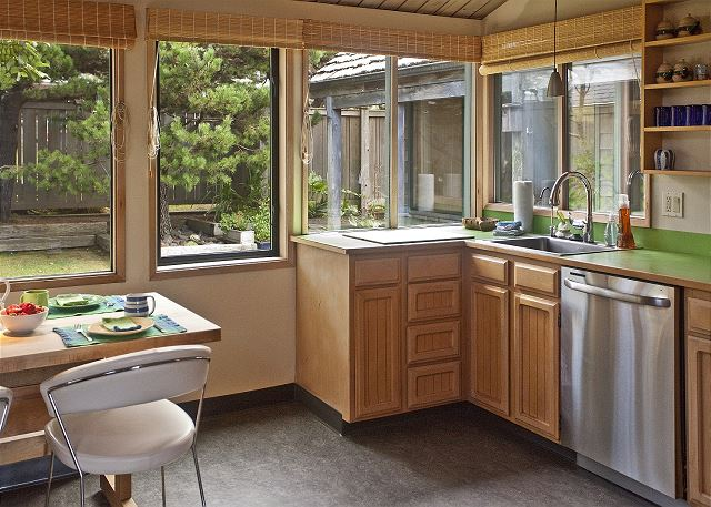 Kitchen looks out into your private courtyard