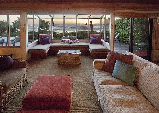 The living room with atrium-style window seating provides the perfect front row seat for the sunset