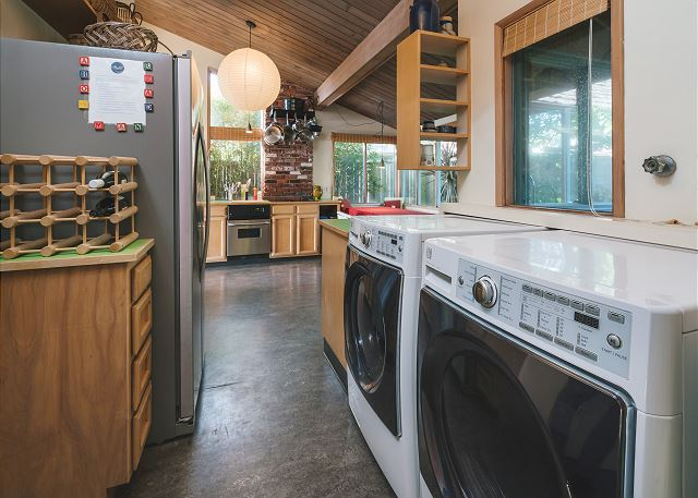 Full sized washer and dryer adjacent to the kitchen, we provide the detergent