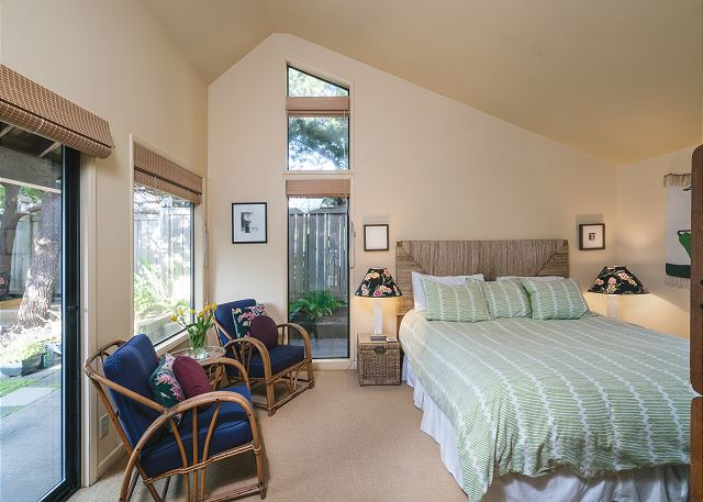 Vaulted ceilings and direct access to the courtyard give this bedroom an airy feel