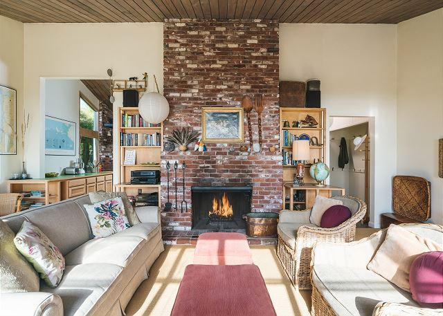 The floor to ceiling fireplace makes this living room extra cozy