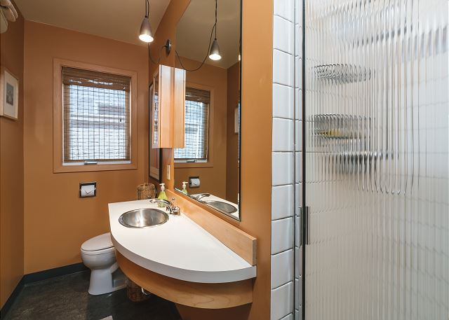 Second bathroom with walk-in shower and retro stylings