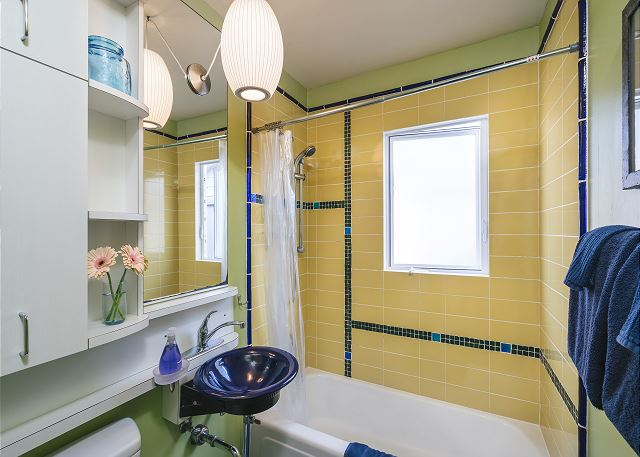 Retro tile in this sunny bathroom with modern conveniences