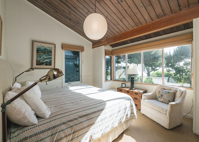 West-facing master bedroom with vaulted ceiling and ocean views