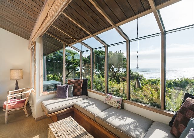 The atrium-style window seat is a great spot for your morning coffee or a book on a misty coastal day