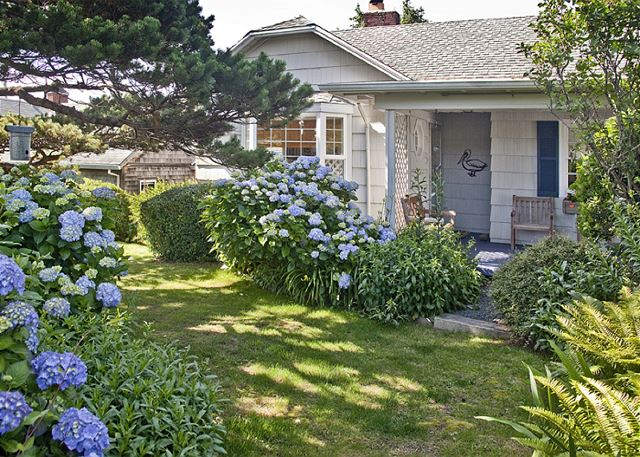 Beautiful front yard on a quiet street - beach access is just 1/2 block away!
