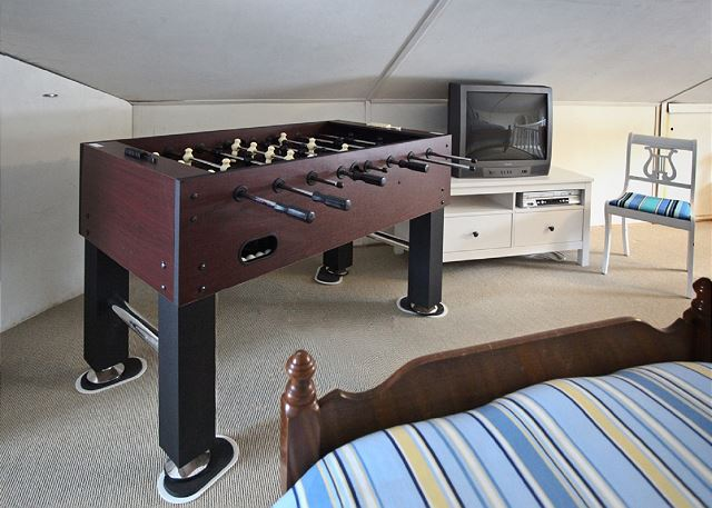 Hip upstairs kids' pad with Foosball table, TV and DVD/VHS player